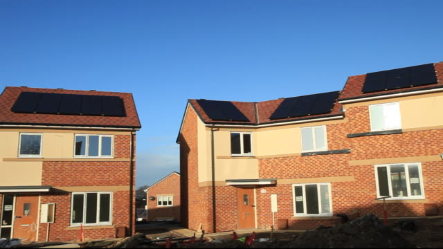 gentoo house builder's hutton rise housing development in sunderland, uk. hutton roof sets new standards in green build. many of the houses are zero carbon, highly thermally efficient and incur minimal running costs.  all of the houses have either solar th - building activity stock videos & royalty-free footage