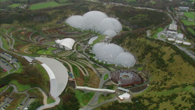 aerial, geodesic biome domes of eden project, st austell, cornwall, england - cornwall england stock videos & royalty-free footage