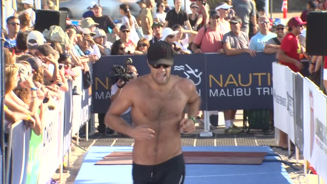 geoff stults arrives at finish line at 26th annual nautica malibu triathlon on 9/16/12 in malibu ca - nautica malibu triathlon stock videos & royalty-free footage