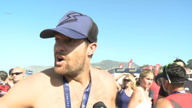 geoff stults on being here again this year, on why comes back year after year at nautica malibu triathlon presented by equinox in los angeles, ca... - ジェフ スタルツ点の映像素材/bロール