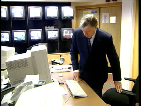 critical report lib england london geoffrey robinson sitting talking on phone northern ireland belfast ext peter mandelson mp along into building - bribing stock videos & royalty-free footage