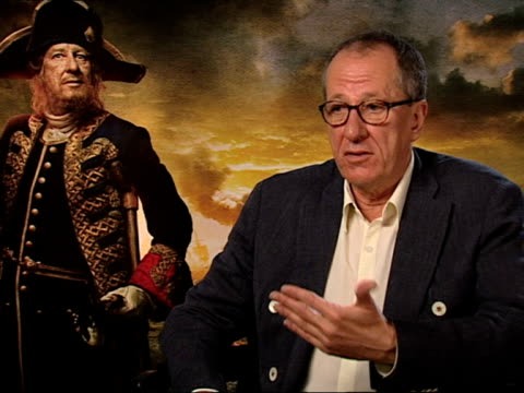 geoffrey rush on new cast members the sequel new dynamics and more at the pirates of the caribbean on stranger tides junkets at london england - dynamics stock videos and b-roll footage