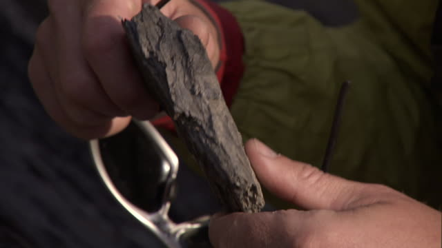 a geologist inspects a rock shard. - geologist stock videos & royalty-free footage