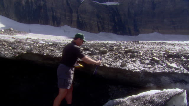 a geologist runs tests in glacier national park, montana. - geologist stock videos & royalty-free footage