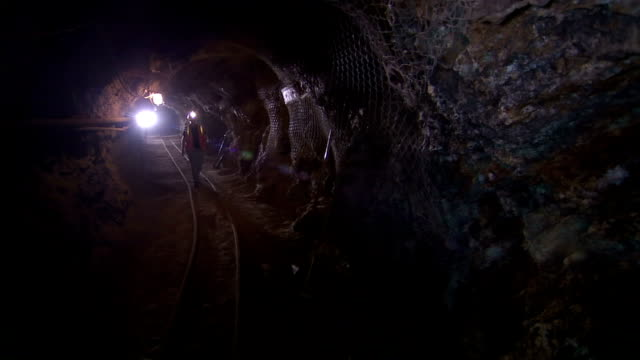 a geologist walks through a tunnel and looks at mineral deposits. - geologist stock videos & royalty-free footage