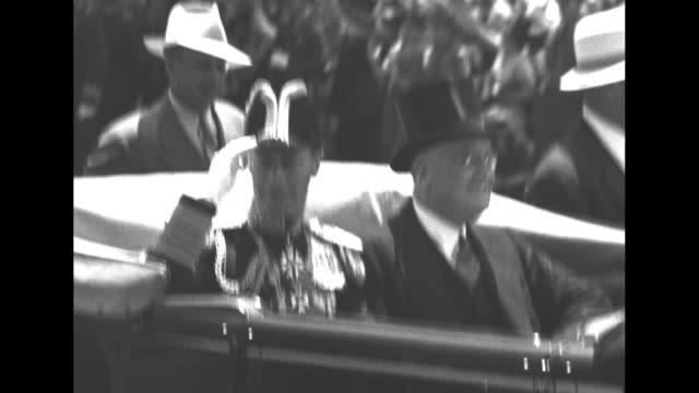 vs george and roosevelt seated in rear seat of limousine secret service agents alongside car wearing panama hats - top hat stock videos & royalty-free footage