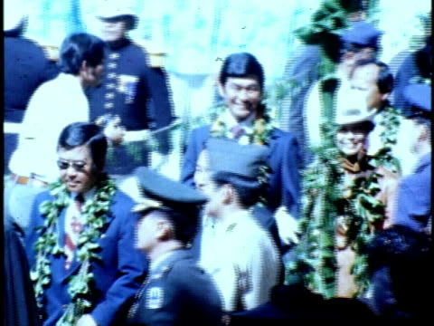 george ariyoshi wearing lei, walking through crowd with his wife and entourage at hawaiian governor inauguration ceremony/ hawaii islands, usa/ audio - kompletter anzug stock-videos und b-roll-filmmaterial