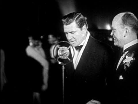 "george bancroft in tuxedo talking into microphone at ""interference"" premiere / newsreel - 1928 stock videos & royalty-free footage"