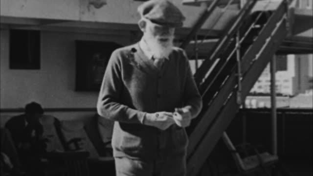 george bernard shaw walking outdoors / miami, florida, usa - ジョージ バーナード ショー点の映像素材/bロール