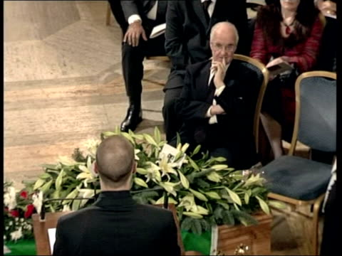 george best funeral held in belfast; pool northern ireland: belfast: stormont: int roy gordon speaking sot - they were the best of times and worst of... - 四旬節点の映像素材/bロール