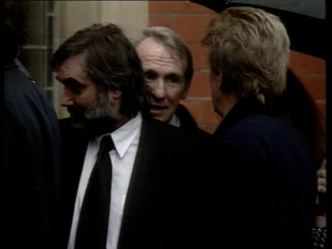 george best given the freedom of the northern ireland borough where he grew up; lib england: manchester best standing with dennis law at funeral of... - ブンブン鳴る点の映像素材/bロール