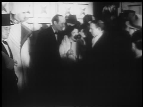 """vídeos y material grabado en eventos de stock de george burns + gracie allen at microphone at """"jumbo"""" opening / hippodrome theater - pareja de mediana edad"""