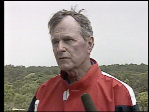 vídeos de stock, filmes e b-roll de / george bush on golf course makes comment to press about how he feels a frustration and grief at innocent people being killed / brief of tennessee... - a. gore
