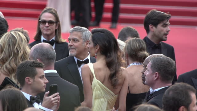 SLOMO George Clooney Amal Clooney at Money Monster' Red Carpet on May 12 2016 in Cannes France