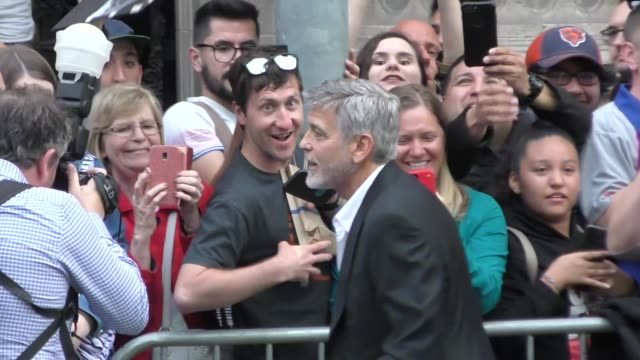 george clooney & amal clooney greet fans outside the catch-22 premiere at tcl chinese theatre in hollywood in celebrity sightings in los angeles, - ジョージ・クルーニー点の映像素材/bロール