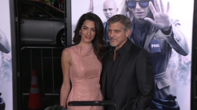"george clooney and amal alamuddin at the ""our brand is crisis"" los angeles premiere at tcl chinese theatre on october 26, 2015 in hollywood,... - ジョージ・クルーニー点の映像素材/bロール"