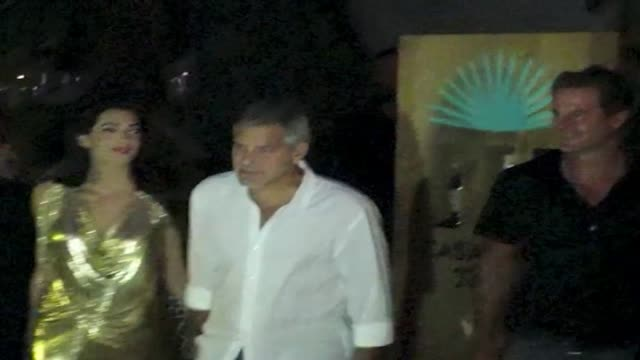 george clooney and amal alamuddin attend the official launch of casamigos tequila in ibiza - ジョージ・クルーニー点の映像素材/bロール