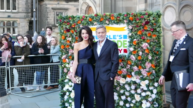 george clooney and amal clooney attend the people's postcode lottery charity gala photocall in edinburgh on march 14, 2019 in edinburgh, scotland. - ジョージ・クルーニー点の映像素材/bロール