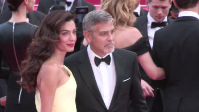 george clooney and his beautiful wife amal on the red carpet for the premiere of money monster at the cannes film festival 2016 thursday 12th may... - george clooney stock videos & royalty-free footage