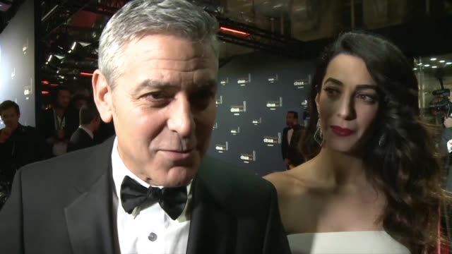 George Clooney and his wife Amal grace the red carpet at the Cesars France's equivalent of the Oscars with the US star set to get an honourary award