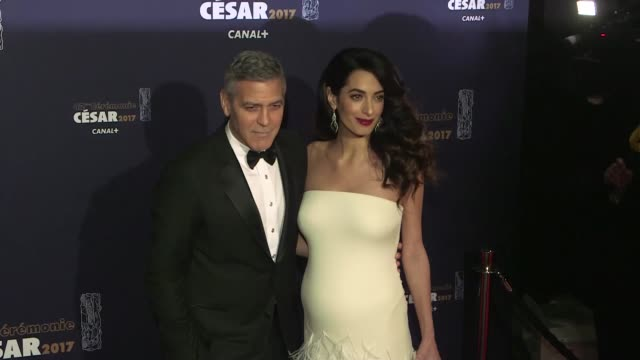 George Clooney and pregnant with twins wife Amal Clooney at the photocall of the 2017 Cesar film award ceremony in Paris on February 24 2017 in Paris...
