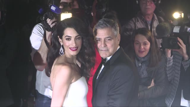 George Clooney and pregnant with twins wife Amal Clooney during interviews atthe 2017 Cesar film award ceremony in Paris on February 24 2017 in Paris...
