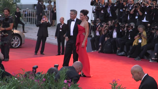 george clooney and sandra bullock at the opening ceremony - 'gravity' red carpet in venice, italy, on 8/28/13. - george clooney stock videos & royalty-free footage
