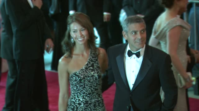 george clooney and sara larson at the superheroes fashion and fantasy costume institute gala at the metropolitan museum of art at the metropolitan... - 2008 stock videos & royalty-free footage