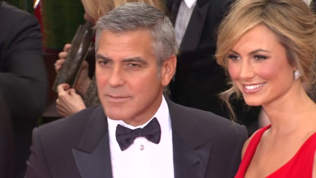 george clooney and stacy keibler at 69th annual golden globe awards arrivals on january 15 2012 in beverly hills california - george clooney stock videos and b-roll footage