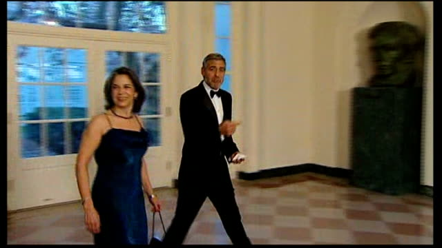 george clooney arrested during sudan protest; 14.3.2012 white house: int **flashlight photography** george clooney announced as arriving for white... - state dinner stock videos & royalty-free footage