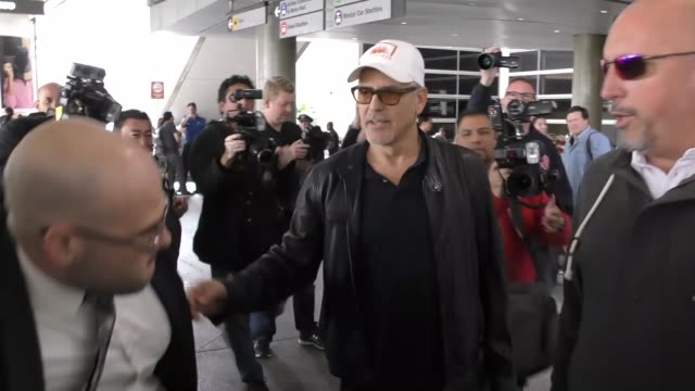 George Clooney arriving at LAX Airport in Los Angeles in Celebrity Sightings in Los Angeles