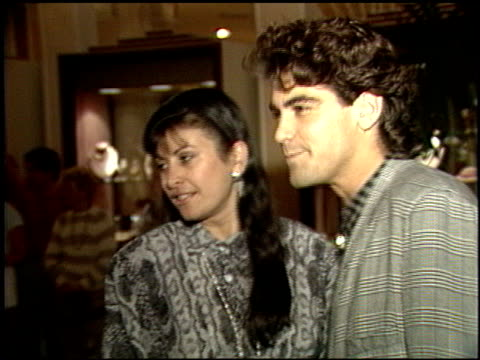 george clooney at the amnesty international party at the beverly hilton in beverly hills, california on september 16, 1986. - ジョージ・クルーニー点の映像素材/bロール