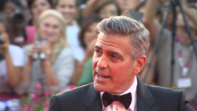 george clooney at the opening ceremony - 'gravity' red carpet in venice, italy, on 8/28/13. - ジョージ・クルーニー点の映像素材/bロール
