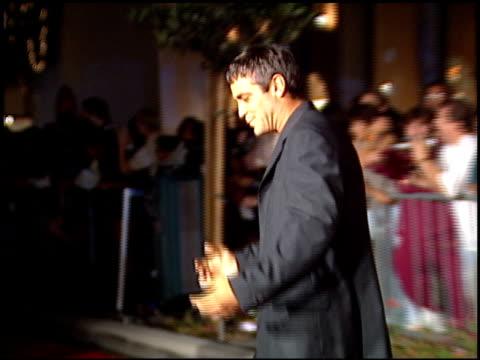 vídeos de stock, filmes e b-roll de george clooney at the planet hollywood entrances on september 17, 1995. - george clooney