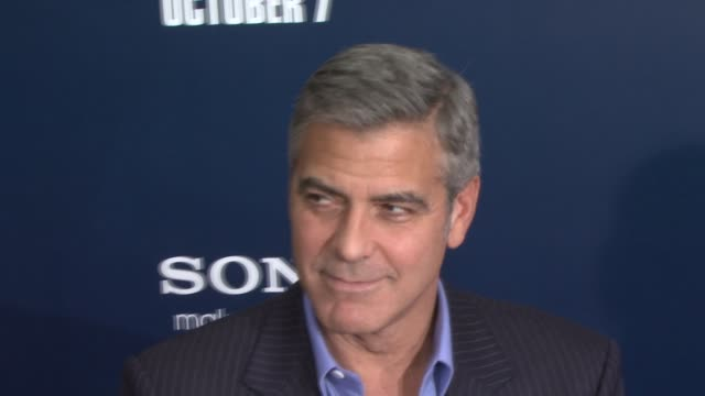 george clooney at the 'the ides of march' new york premiere - red carpet at new york ny. - ジョージ・クルーニー点の映像素材/bロール