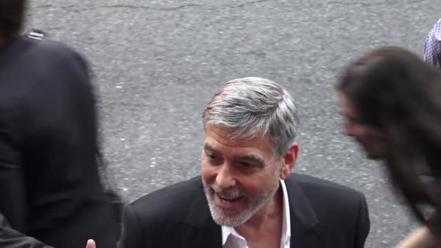 george clooney greets fans outside the catch 22 premiere at tcl chinese theatre in hollywood in celebrity sightings in los angeles, - ジョージ・クルーニー点の映像素材/bロール