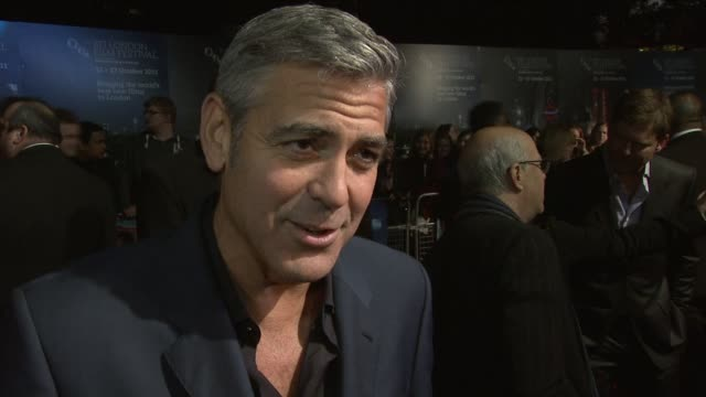 george clooney on being a actor/director, ryan gosling, doing more directing at the the ides of march american express gala premiere: 55th bfi london... - george clooney bildbanksvideor och videomaterial från bakom kulisserna