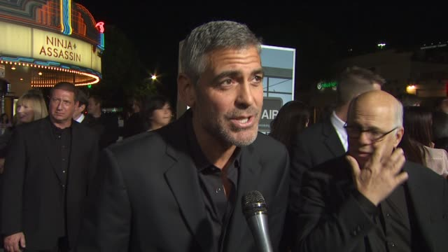 george clooney on if he thinks about the oscars while making a film, on how he keeps looking better with age, on why he wanted to be part of this... - george clooney stock videos & royalty-free footage