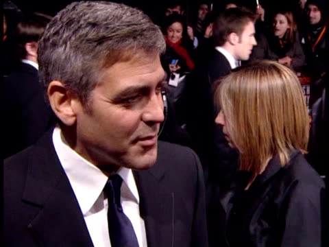vídeos de stock, filmes e b-roll de george clooney on the film 'syriana'. at the the orange british academy film awards 2006 - red carpet at london . - george clooney