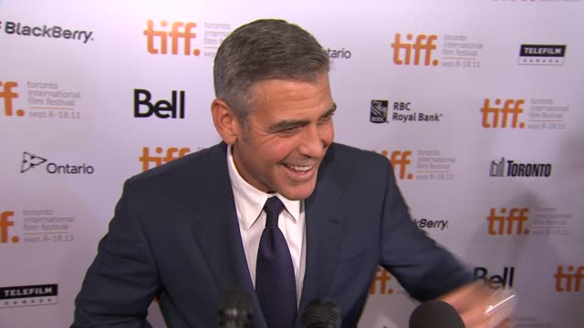 george clooney on the political environment changing on getting the film made at the 'ides of march' premiere 2011 toronto international film... - george clooney stock videos and b-roll footage