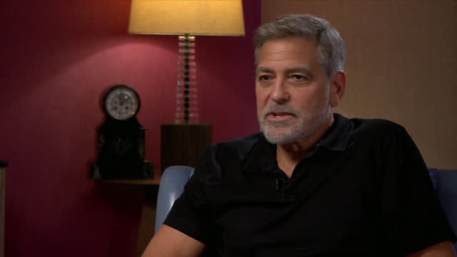 """george clooney saying there is """"a lot of healing"""" needed in the usa, and that joe biden's administration """"needs time"""" - moving down stock videos & royalty-free footage"""