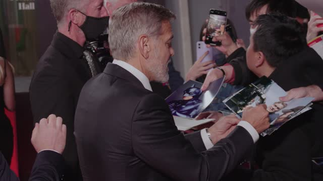 """george clooney signs autographs for fans at """"the tender bar"""" uk premiere during the 65th bfi london film festival at the royal festival hall on... - premiere stock videos & royalty-free footage"""