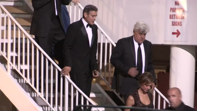 george clooney, stacy keibler & jay leno depart 26th anniversary carousel of hope ball in beverly hills, 10/20/12 - tv司会 ジェイ・レノ点の映像素材/bロール
