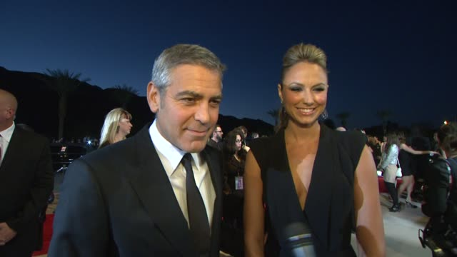 George Clooney Stacy Keibler on how it feels to be a part of the Palm Springs International Film Festival receiving the Chairman's Award what makes...