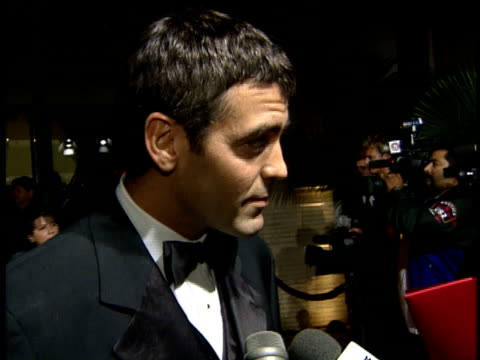 George Clooney talks to reporter about marriage on the red carpet