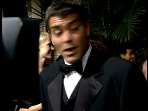 George Clooney talks to reporter on the red carpet