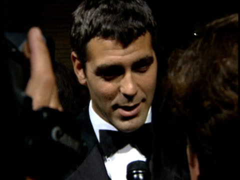 george clooney talks to reporters on the red carpet. - george clooney stock videos & royalty-free footage