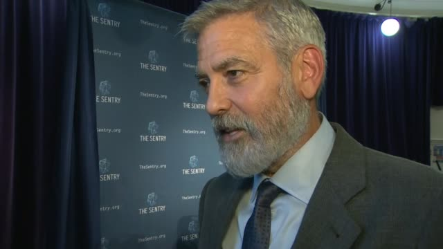 george clooney's investigative group sentry warns of south sudan's 'corrupt' government; england: london: int george clooney interview sot - re... - ジョージ・クルーニー点の映像素材/bロール