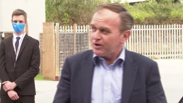 george eustice visits battersea dogs and cats home; england: london: battersea dogs and cats home: ext george eustice mp out of car and meeting peter... - stroking stock videos & royalty-free footage
