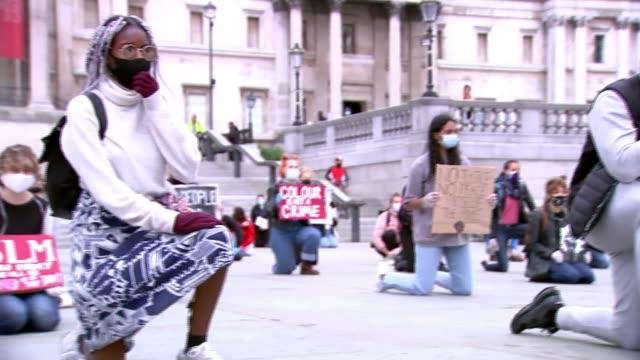 black lives matter demonstration in london; uk, london: black lives matter protesters 'take the knee' during demonstration in trafalgar square.... - fist stock videos & royalty-free footage